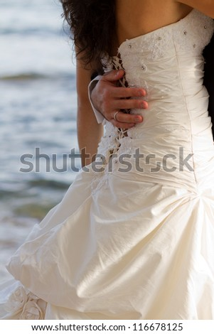 First wedding dance with crystal blue sea on the background - stock photo