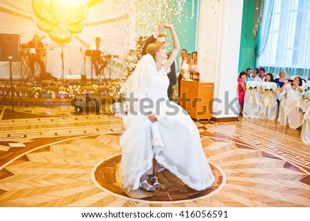 First wedding dance with golden confetti - stock photo