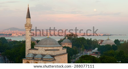 Firuz Aga Mosque and panoramic view of Istanbul city during sunset time. Istanbul, Turkey. - stock photo