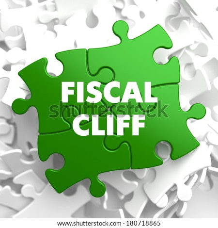 Fiscal Cliff on Green Puzzle on White Background. - stock photo