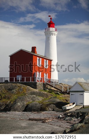 Fisgard lighthouse on Canada's west coast is still in operation!  The lighthouse was constructed in 1860 at the entrance to Esquimalt harbour, in Victoria, Vancouver Island, BC - stock photo