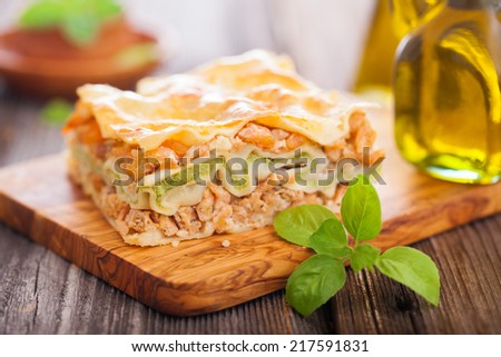 Fish and broccoli mousse lasagna on a wooden table - stock photo