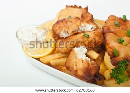 Fish and chips on a plate on white background - stock photo