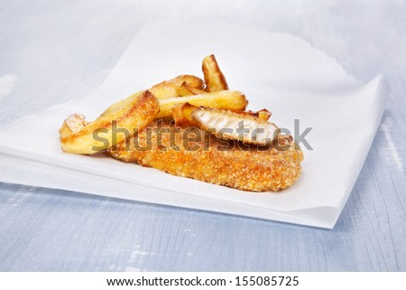 Fish and chips on blue wooden background. Delicious seafood background.  - stock photo