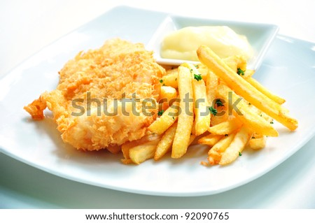 Fish and chips served with mayo - stock photo