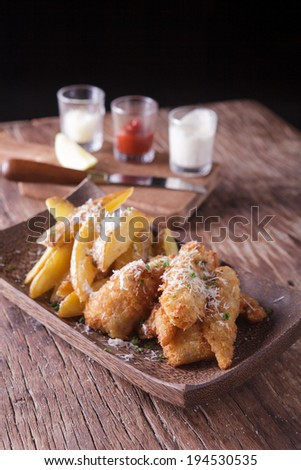 fish and chips with tartar sauce - stock photo