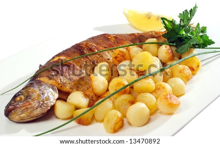 fish and potatoes served in the restaurant - stock photo