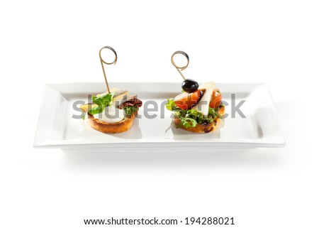 Fish and Vegetables Canapes over White - stock photo