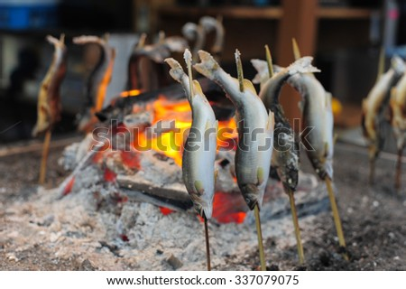 Fish Ayu with salt being grilled in Japan , Japanese grill style - stock photo