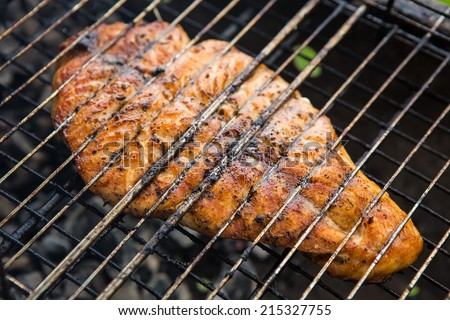 Fish background. Vegetables char-grilled over flame
