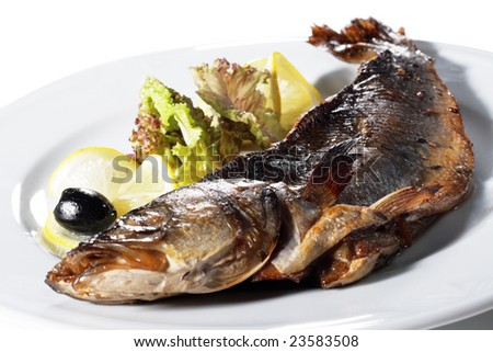 Fish Baked in Spicy Served with Salad Leaves, Lemon and Olives. Isolated on White Background