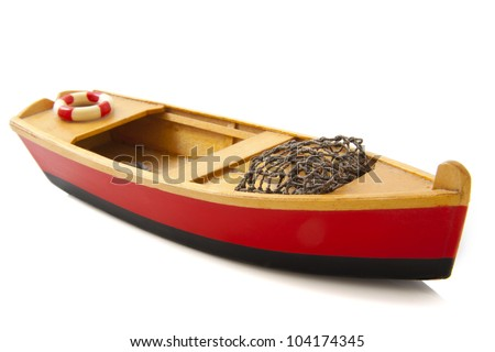 Fish boat in red and black isolated over white - stock photo