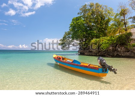 Fish boat on the paradise beach of Jamaica - stock photo