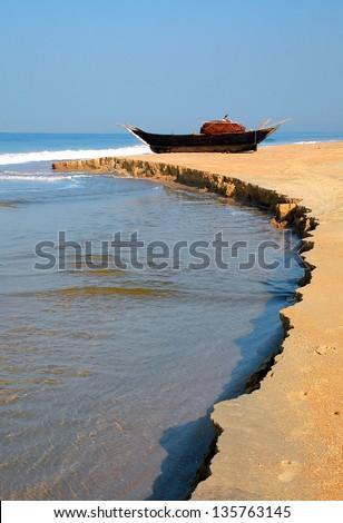 Fish-boat on the shore of the Arabian Sea in Goa, India - stock photo