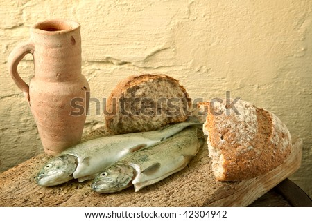 Fish, bread and wine as symbols of Jesus life - stock photo