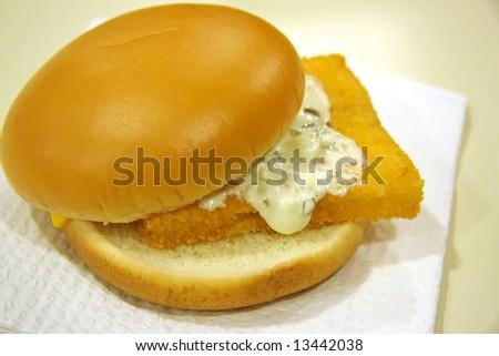 Fish burger seafood fast food sandwich on bun - stock photo