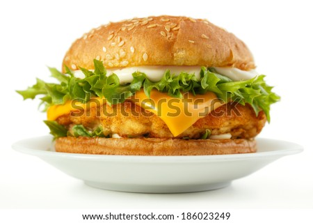 Fish burger with cheese and mayonnaise on dish, white background - stock photo
