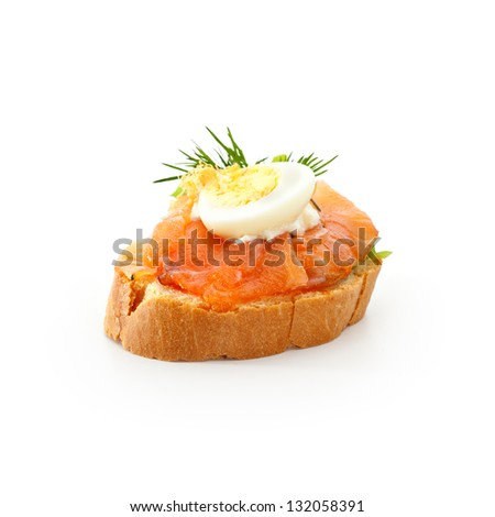 Fish Canapes - Graved Salmon Fillet with Egg and Horseradish Cream - stock photo