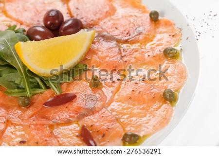 Fish Carpaccio with salad  - stock photo