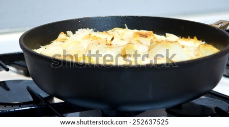 Fish casserole with rice in pan