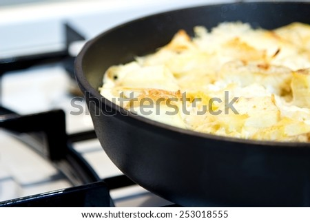 Fish casserole with rice in pan. Selective focus with blurred background - stock photo