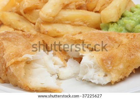Fish & chips and mushy peas - stock photo