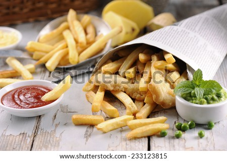 Fish & Chips served in the newspaper   - stock photo