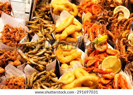 Fish & Chips served in the newspaper on a market stall. Fish and chips takeout portions.
