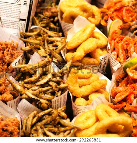 Fish & Chips served in the newspaper on a market stall. Fish and chips takeout portions.  - stock photo