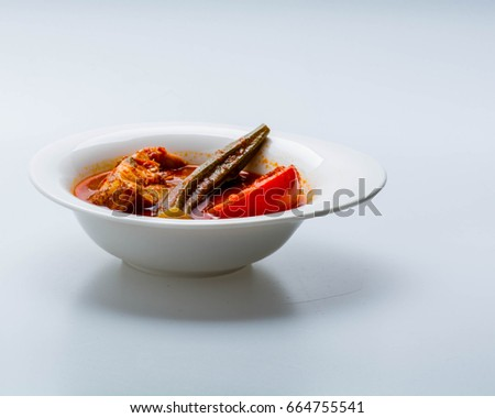 Fish cooked in hot and sour sauce red snapper asam pedas