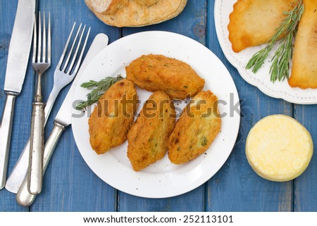 fish croquettes on white plate - stock photo