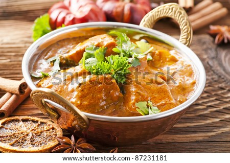fish curry in copper pot - stock photo