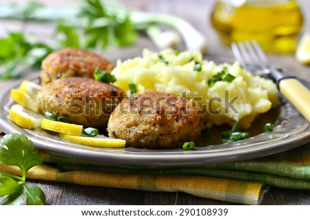 Fish cutlets with greens. - stock photo