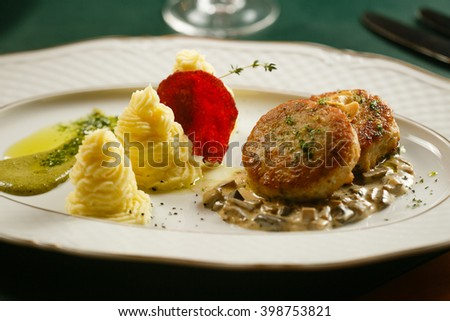 Fish cutlets with mashed potatoes and two sauces