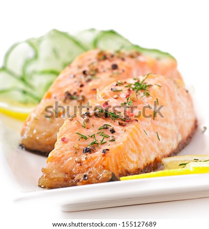 Fish dish - grilled salmon with vegetables - stock photo