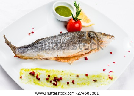 Fish dish - roasted fish and vegetables - stock photo