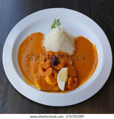 Fish dish served in Peruvian Restaurant - stock photo
