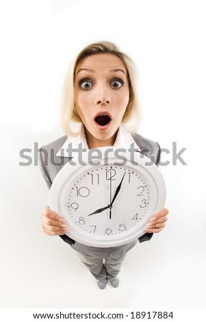 Fish-eye of businesswoman opening her mouth in amusement showing clock - stock photo