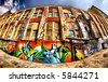 Fish Eye shot of a beautiful graffiti coloured building - stock photo
