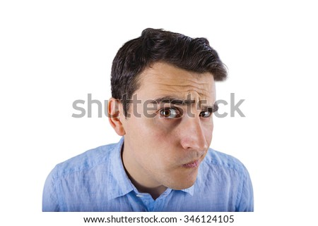 Fish-eye shot of a smiling student looking to camera.Student thinking for something with a funny face looking to camera. - stock photo