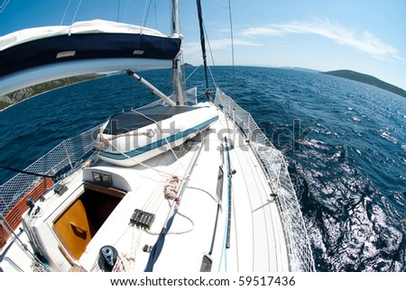 fish-eye view of a yacht on a blue sea - stock photo