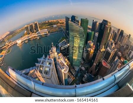 Fish-eye view of Singapore city skyline at sunset.  - stock photo