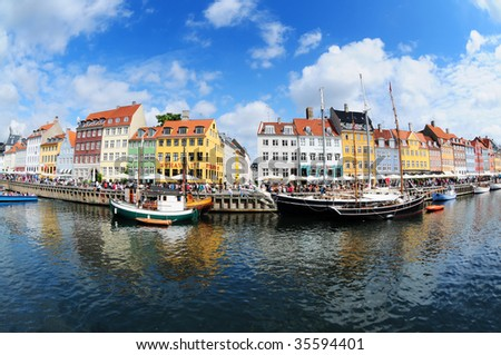 Fish eye view on colorful houses and boats in famous canal Nyhavn in Copenhagen, Denmark - stock photo