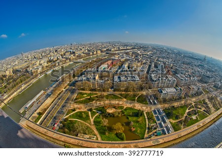 Fish-eye wide angle view over Paris from Eiffel Tower - stock photo