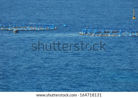 Fish Farm in the Atlantic Ocean on a Blue Day