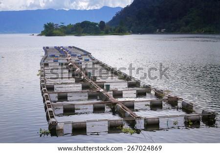 Fish farm on the Lake Maninjau. Lake Maninjau (Danau Maninjau) is a caldera lake in West Sumatra, Indonesia. - stock photo