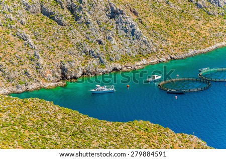 Fish farms with cages in sea bay on Greek Island, Greece - stock photo