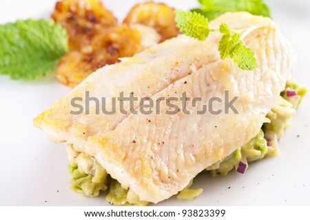 Fish fillet with avocado tatar - stock photo