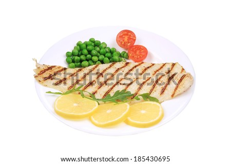 Fish fillet with vegetables. Isolated on a white background. - stock photo