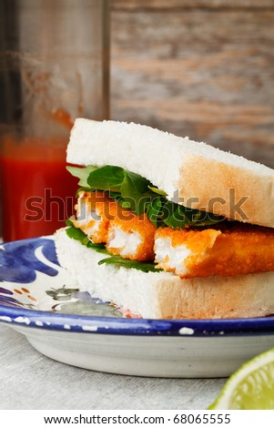Fish finger sandwich on a plate - stock photo